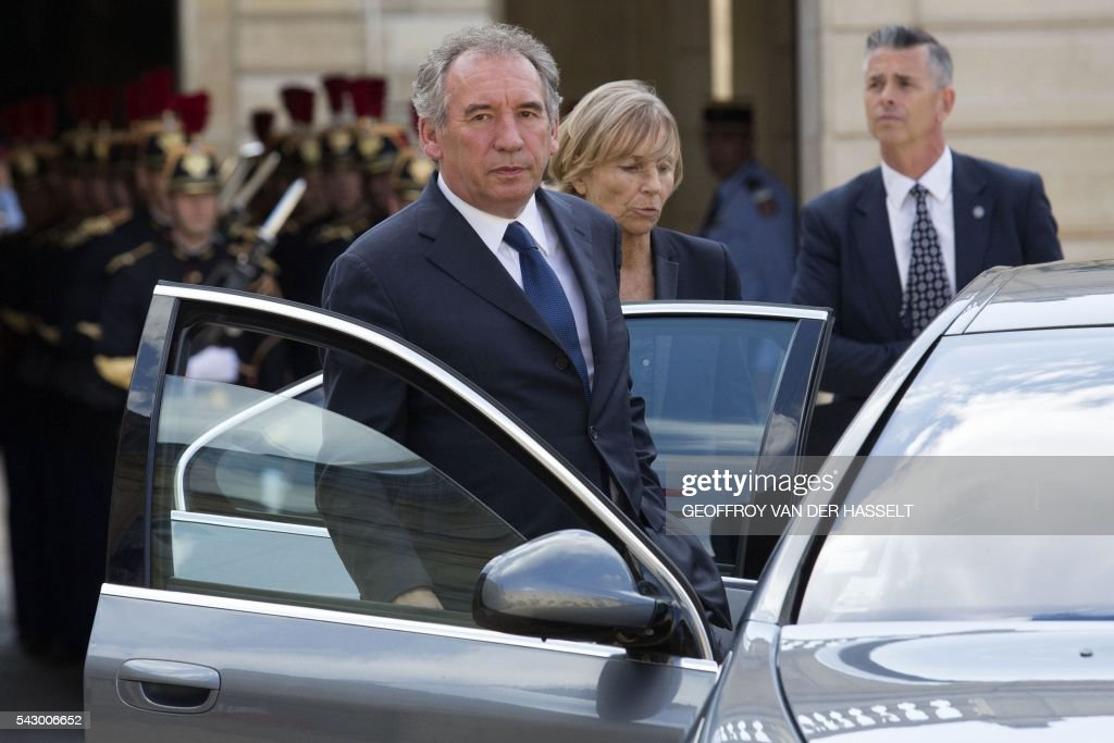 Leader of French MoDem centrist party Francois Bayrou (L) and MoDem member Marielle de Sarnez (R) leave after a meeting with French President on June 25, 2016 at the Elysee Palace in Paris, after Britain voted to leave the European Union a day before. Europe's press was awash with gloom and doom over Brexit on June 25, warning that it was a boon for nationalists while urging EU leaders to meet the challenge of their 'rendezvous with history'. / AFP / GEOFFROY