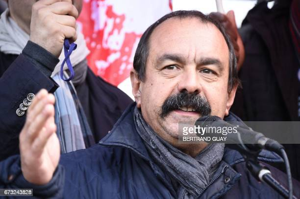 Leader of French union CGT Philippe Martinez speaks during a demonstration by employees of French carmaker PSA Peugeot Citroen to call to preserve...