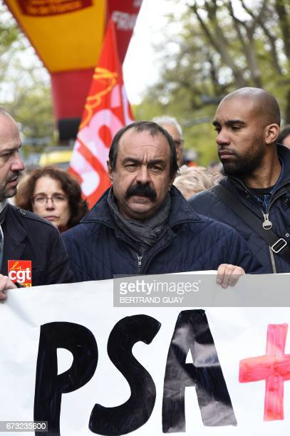 Leader of French union CGT Philippe Martinez takes part in a demonstration by employees of French carmaker PSA Peugeot Citroen to call to preserve...