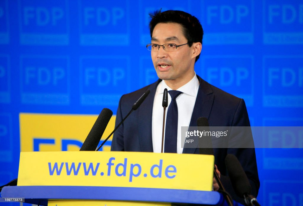 Leader of Germany's Free Democratic party (FDP) and Economy Minister Philipp Roesler speaks at the FDP headquarter in Berlin on January 20, 2013 on polling day of the local elections in the central German state of Lower Saxony. The vote is largely seen as a test run for Chancellor Angela Merkel, her rivals and would-be heirs, eight months before nationwide polls. German Chancellor Angela Merkel's party was ahead after the first state poll in a general election year, exit polls indicated, but it was unclear whether its coalition would cling to power. AFP PHOTO / FREDERIC LAFARGUE