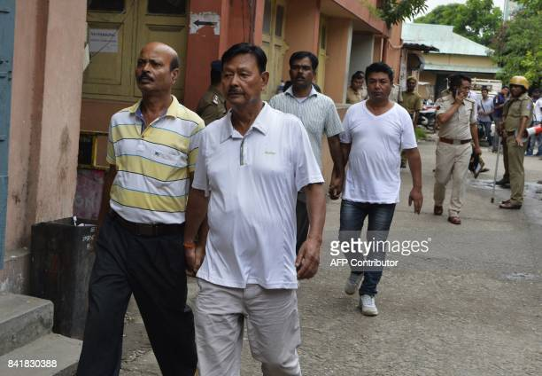 Leader of Gorkha Janamukti Morcha Dawa lama and party member Raju Biswakarma are escorted by West Bengal police following their arrest on Septmeber 1...
