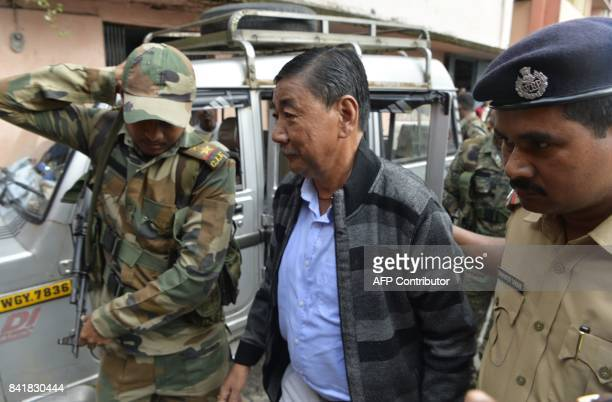 Leader of Gorkha Janamukti Morcha Krishna Limbu is escorted by West Bengal police following his arrest on Septmeber 1 during court proceedings in...