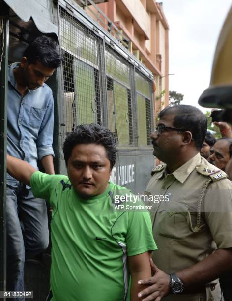 Leader of Gorkha Janamukti Morcha Sanjit Tamang is escorted by West Bengal police following his arrest on Septmeber 1 during court proceedings in...