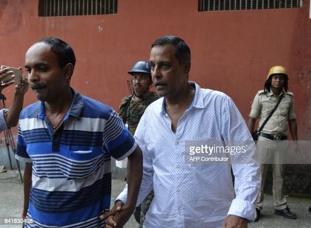 Leader of Gorkha Janamukti Morcha Sankar Adhikary is escorted by West Bengal police following his arrest on Septmeber 1 during court proceedings in...