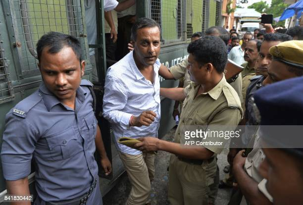 Leader of Gorkha Janamukti Morcha Shankar Adhikary is escorted by West Bengal police following his arrest on Septmeber 1 during court proceedings in...
