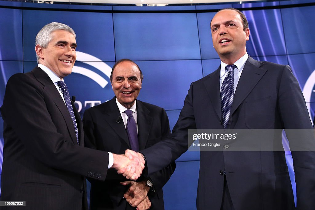 Leader of Italy's centrist Catholic UDC party Pier Ferdinando Casini, TV conductor <a gi-track='captionPersonalityLinkClicked' href=/galleries/search?phrase=Bruno+Vespa&family=editorial&specificpeople=621702 ng-click='$event.stopPropagation()'>Bruno Vespa</a> and secretary general of the Popolo della Liberta (PDL) party <a gi-track='captionPersonalityLinkClicked' href=/galleries/search?phrase=Angelino+Alfano&family=editorial&specificpeople=5101299 ng-click='$event.stopPropagation()'>Angelino Alfano</a>, attend 'Porta a Porta' Italian TV Show, while portraits of Silvio Berlusconi, Mario Monti and Pierluigi Bersani are displayed in the background on January 16, 2013 in Rome, Italy.