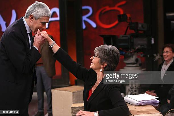 Leader of Italy's centrist Catholic UDC party Pier Ferdinando Casini kisses hand to the to centreleft candidate of Democratic Party Anna Finocchiaro...