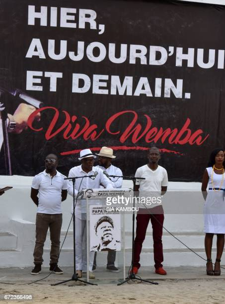 Leader of Ivorian music band Magic System A'Salfo delivers a speech next to other members of the band during a tribute to late Congolese rumba star...