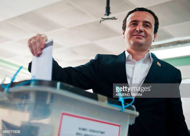 Leader of Kosovo's opposition party 'Vetvendosje' Albin Kurti casts his ballot at a polling station in Pristina on June 8 during Kosovo's...