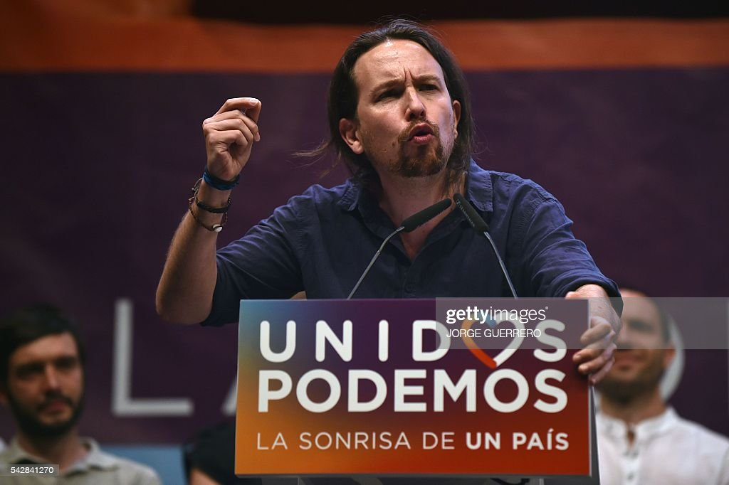 Leader of left wing party Podemos and party candidate Pablo Iglesias speaks during the partys final campaign meeting in Madrid on June 24, 2016 ahead of the June 26 general election. Spain votes again on June 26, six months after an inconclusive election which saw parties unable to agree on a coalition government. GUERRERO