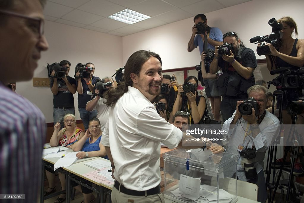 Leader of left wing party Podemos and party candidate, Pablo Iglesias, poses as he casts his vote in Spains general election at a polling station in cental Madrid on June 26, 2016. Spain votes today, six months after an inconclusive election which saw parties unable to agree on a coalition government. GUERRERO