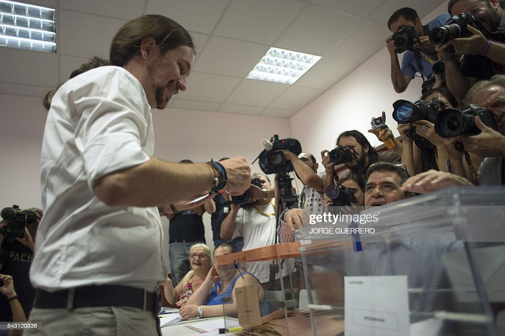 Leader of left wing party Podemos and party candidate, Pablo Iglesias, prepares his ballot to vote in Spains general election at a polling station in cental Madrid on June 26, 2016. Spain votes today, six months after an inconclusive election which saw parties unable to agree on a coalition government. GUERRERO