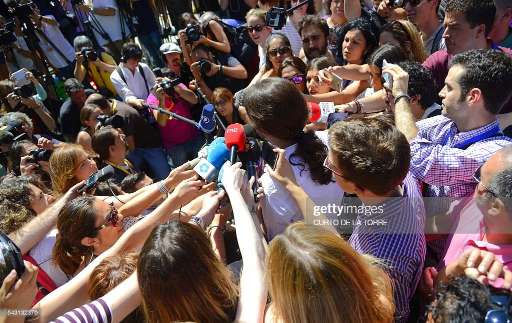 Leader of left wing party Podemos and party candidate, Pablo Iglesias, speaks to the press after voting in Spains general election at a polling station in cental Madrid on June 26, 2016. Spain votes today, six months after an inconclusive election which saw parties unable to agree on a coalition government. TORRE