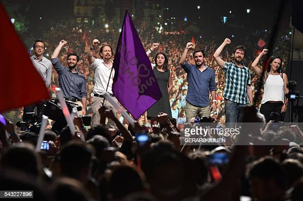 Leader of left wing party Podemos and party candidate Pablo Iglesias raises his fist with leftwing Podemos member and Irene Montero leftwing party IU...