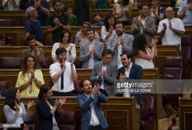 Leader of left wing party Podemos Pablo Iglesias is applauded after a speech at the Congress of Deputies in Madrid on June 13 2017 before a vote of...