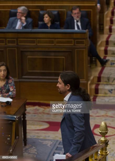 Leader of left wing party Podemos Pablo Iglesias returns to his seat after a speech at the Congress of Deputies in Madrid on June 13 2017 before a...