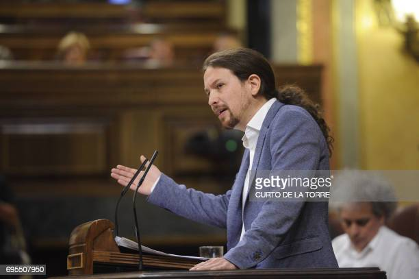 Leader of left wing party Podemos Pablo Iglesias speaks at the Congress of Deputies in Madrid on June 13 2017 before a vote of no confidence tabled...