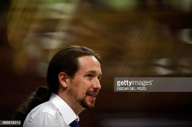 Leader of left wing party Podemos Pablo Iglesias speaks at the Congress of Deputies in Madrid on June 14 2017 before a vote of no confidence tabled...