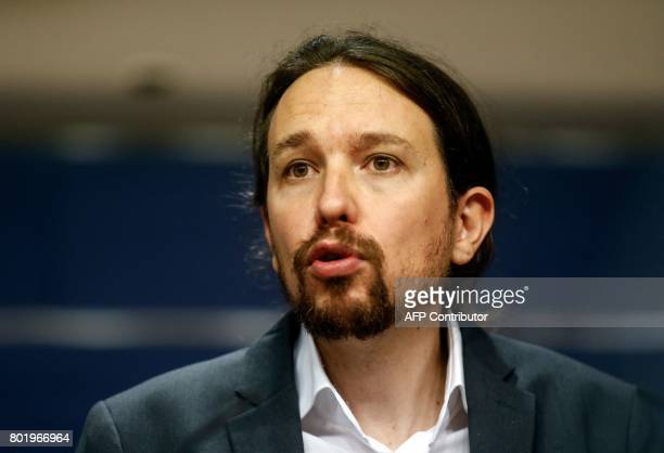 Leader of left wing party Podemos Pablo Iglesias speaks during a press conference following a meeting with leader of Spanish Socialist Party Pedro...