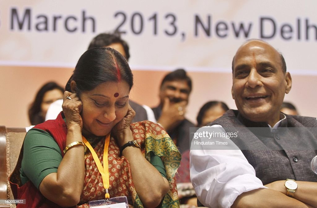 Leader of Opposition, Lok Sabha Sushma Swaraj and BJP party president Rajnath Singh during the last day of the Party National Council Meeting on March 3, 2013 in New Delhi, India. Party meeting, which is aimed at strategising for the upcoming assembly and general elections as also looking at a reorganisation of the party structure.