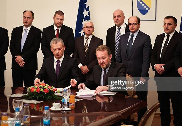 Leader of Party of Democratic Action Bakir Izetbegovic and Leader of Union for a Better Future Fahrudin Radoncic sign a coalition agreement in...