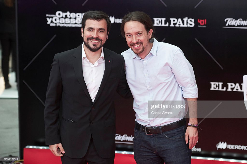 Leader of party Podemos Pablo Iglesias (R) and leader of party Izquierda Unida Alberto Garzon (L) attend 'Ortega Y Gasset' journalism awards 2016 at Palacio de Cibeles on May 05, 2016 in Madrid, Spain.