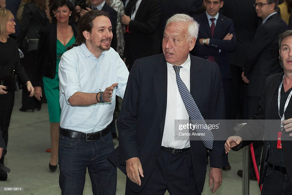 Leader of party Podemos Pablo Iglesias (L) and Spanish Foreign Minister <a gi-track='captionPersonalityLinkClicked' href=/galleries/search?phrase=Jose+Manuel+Garcia+Margallo&family=editorial&specificpeople=8756020 ng-click='$event.stopPropagation()'>Jose Manuel Garcia Margallo</a> (R) attend 'Ortega Y Gasset' journalism awards 2016 at Palacio de Cibeles on May 05, 2016 in Madrid, .