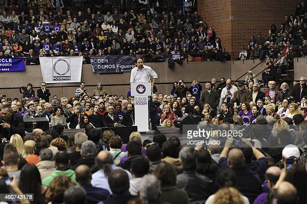 Leader of Podemos a leftwing party that emerged out of the 'Indignants' movement Pablo Iglesias speaks at a party meeting on December 21 2014 in...