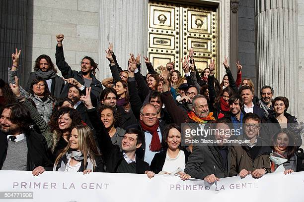 Leader of Podemos party Pablo Iglesias poses amid other members of his party after the inaugural meeting of the eleventh legislature of the Congress...