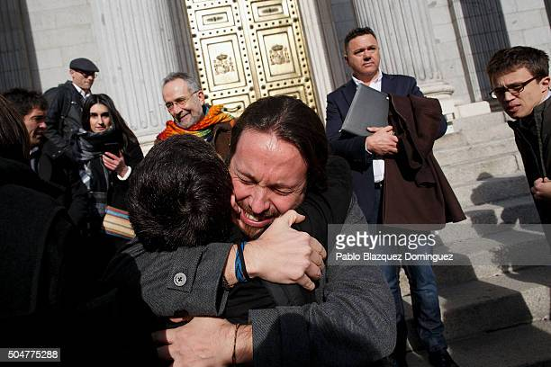 Leader of Podemos party Pablo Iglesias reacts as he hugs people after the inaugural meeting of the eleventh legislature of the Congress of Deputies...