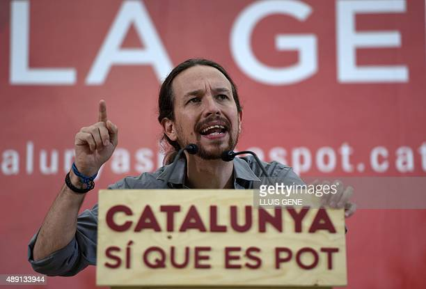 Leader of Podemos political party Pablo Iglesias speaks during a campaign meeting of 'Catalunya Si que es Pot' for the upcoming Catalan regional...