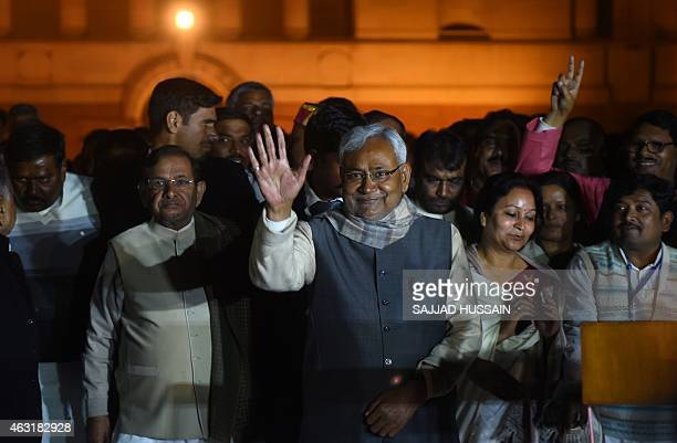 Leader of regional political party Janata DalUnited Nitish Kumar waves to the media after he along with other leaders of ally parties met Indian...