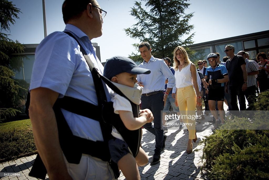 Leader of Socialist Party Pedro Sanchez and his wife Maria Begoña Gomez Fernande leaves after they casted their ballot during the Spanish General elections at a polling station in Madrid on June 26, 2016.