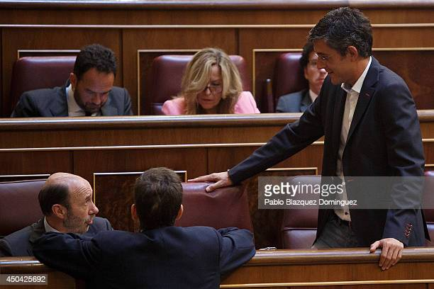 Leader of Spain's Socialist Party Alfredo Perez Rubalcaba speaks with Eduardo Madina during a debate about a new law that would allow the abdication...