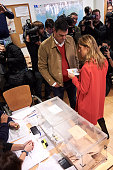 Leader of Spain's Socialist Party and candidate for general elections Pedro Sanchez and his wife Begona Fernandez cast their votes during General...