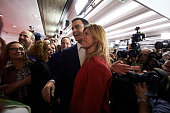 Leader of Spain's Socialist Party and candidate for general elections Pedro Sanchez and his wife Begona Fernandez greet supporters after the first...