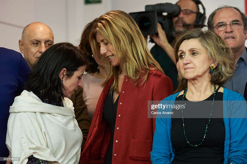 Leader of Spain's Socialist Party (PSOE) and candidate for general elections Pedro Sanchez wife's Begona Fernandez (C) and members of Spain's Socialist Party (PSOE) wait for Pedro Sanchez speech after the first results of the general election were announced on November 20, 2015 at PSOE's headquarters in Madrid. Spaniards went to the polls today to vote for 350 members of the parliament and 208 senators. For the first time since 1982, the two traditional Spanish political parties, right-wing Partido Popular (People's Party) and centre-left wing Partido Socialista Obrero Espanol PSOE (Spanish Socialist Workers' Party), held a tight election race with two new contenders, Ciudadanos (Citizens) and Podemos (We Can) attracting right-leaning and left-leaning voters respectively.