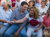 Leader of Spanish Socialist Party and party candidate Pedro Sanchez laughs with President of the regional Government of Andalucia Susana Diaz prior...