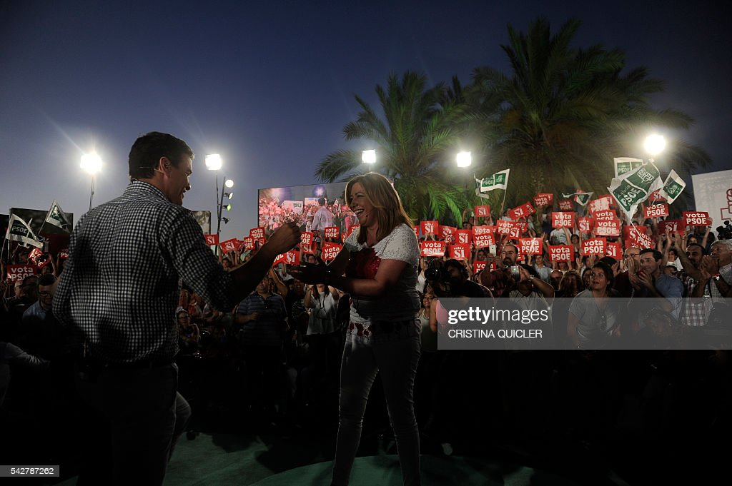 Leader of Spanish Socialist Party (PSOE) and party candidate Pedro Sanchez (L)shares a laugh with President of the regional Government of Andalucia Susana Diaz prior to delivering a speech during the party's final campaign meeting in Sevilla on June 24, 2016 ahead of the June 26 general election. Spain is holding its second elections in six months, on June 26, after being governed by a caretaker government with limited powers since the December 20 polls put an end to the country's traditional two-party system as voters fed up with austerity and corruption scandals flocked to new groups. / AFP / CRISTINA