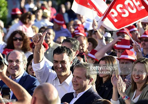 Leader of Spanish Socialist Party Pedro Sanchez smiles and thumbs up next to candidate for Madrid's regional presidency Angel Gabilondo and candidate...