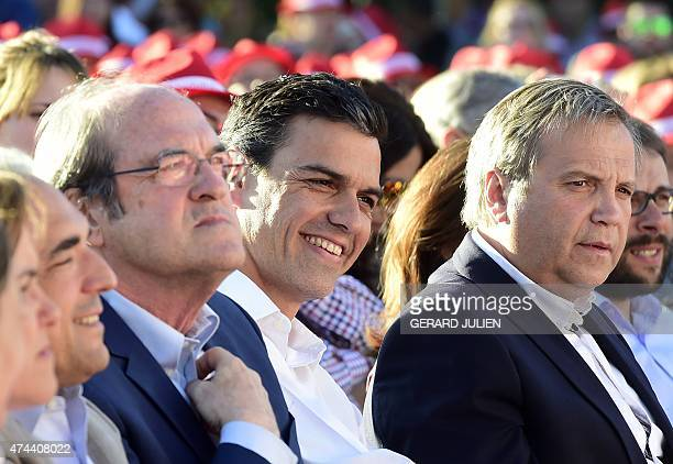 Leader of Spanish Socialist Party Pedro Sanchez smiles next to candidate for Madrid's regional presidency Angel Gabilondo and candidate for mayor of...