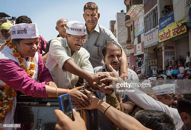 Leader of the AAP and anticorruption activist Arvind Kejriwal center greets supporters while campaigning on April 8 2014 in New Delhi India India is...