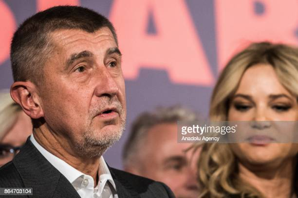 Leader of the ANO movement Andrej Babis answers the questions of press members as he arrives at ANO headquarters after the polling stations of Czech...