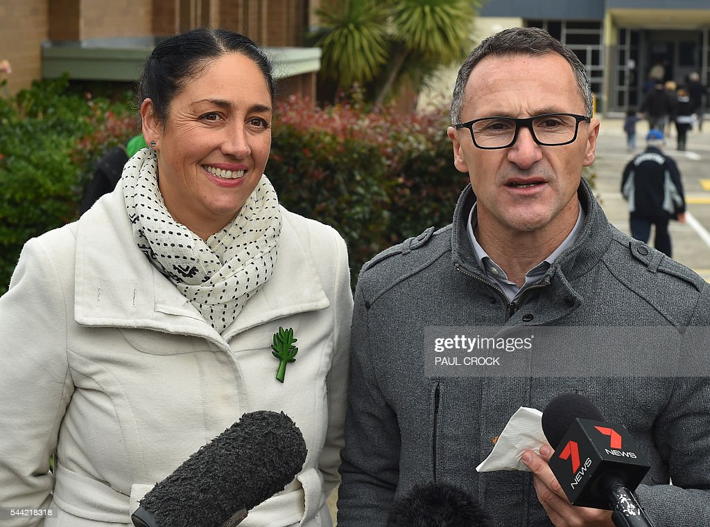 Leader of the Australian Greens Party Richard Di Natale (R) and Greens candidate for the seat of Batman Alex Bhathal (L) talk to to the media after casting their votes in the Australian Federal Election in Melbourne on July 2, 2016. Australia is voting in a general election which is expected to be a close race between the ruling Liberal-National coalition and the opposition Labor Party. / AFP / Paul Crock