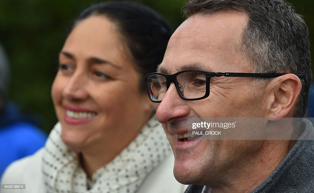 Leader of the Australian Greens Party Richard Di Natale (R) and Greens candidate for the seat of Batman Alex Bhathal (L) are confident of winning the 'safe' Labor seat of Batman in the Australian Federal Election in Melbourne on July 2, 2016. Australia is voting in a general election which is expected to be a close race between the ruling Liberal-National coalition and the opposition Labor Party. / AFP / Paul Crock
