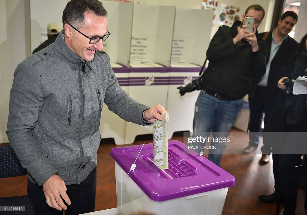 Leader of the Australian Greens Party Richard Di Natale casts his vote in the Australian Federal Election in Melbourne on July 2, 2016. Australia is voting in a general election which is expected to be a close race between the ruling Liberal-National coalition and the opposition Labor Party. / AFP / Paul Crock