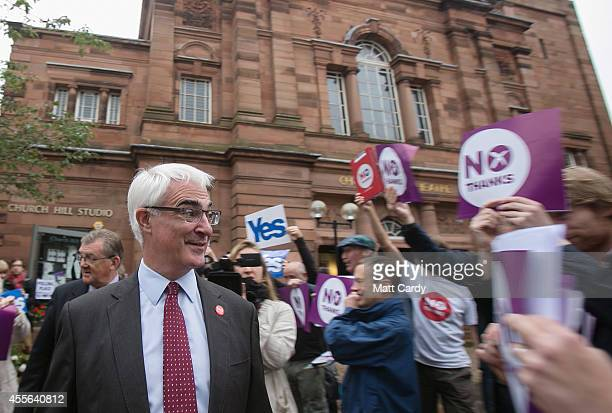 Leader of the Better Together campaign Alistair Darling leaves after casting his vote at Church Hill Theatre polling station in Morningside on...