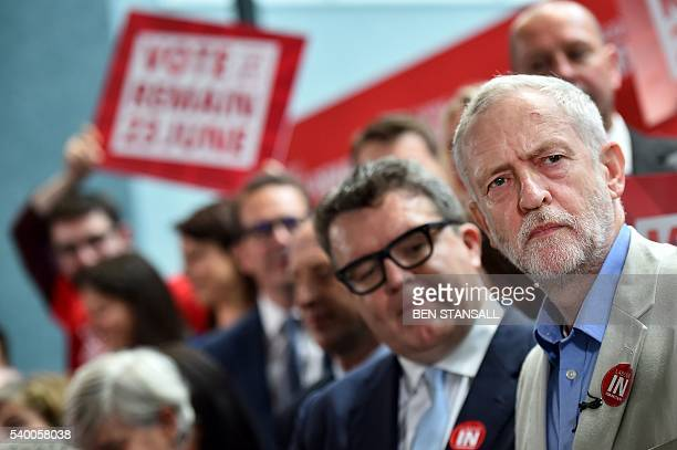 Leader of the British opposition Labour Party Jeremy Corbyn looks on as he poses with Labour Party and TUC members during a photocall for the 'Labour...