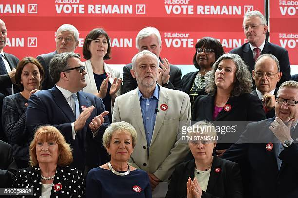 Leader of the British opposition Labour Party Jeremy Corbyn smiles as he poses with members of the shadow cabinet including Deputy leader Tom Watson...