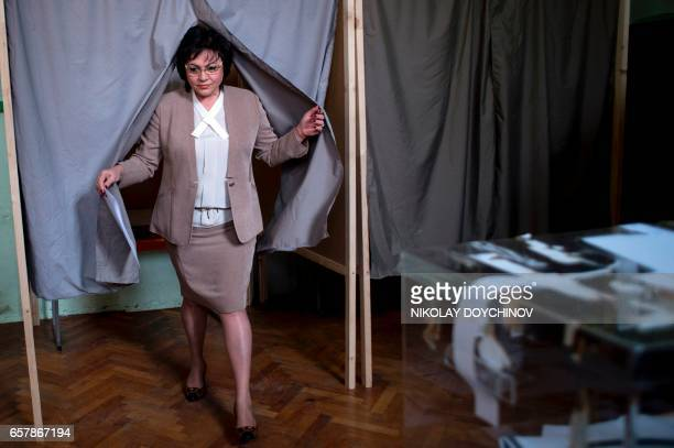 Leader of the Bulgarian Socialist party Kornelia Ninova exits from a voting booth at a polling station in Sofia on March 26 during the country's...